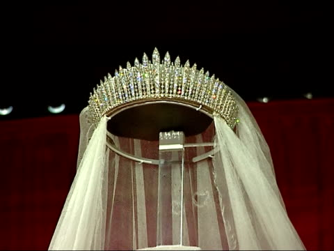 exhibits ENGLAND London INT Wedding dress of Queen Elizabeth II and uniform worn by Prince Philip on their wedding day on display at exhibition to...