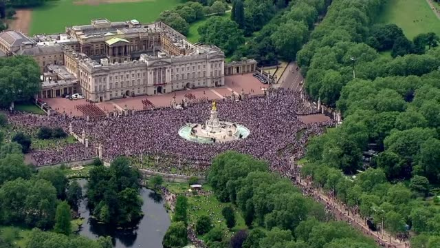 aerials of flypast and crowd air views crowds gathered outside buckingham palace - 90th birthday stock videos and b-roll footage