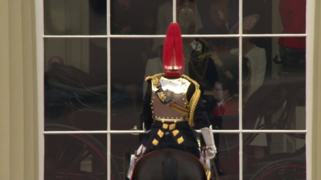 general views of trooping the colour england london buckingham palace ext **audio as incoming** mounted guards outside buckingham palace / obscured... - 90th birthday stock videos and b-roll footage
