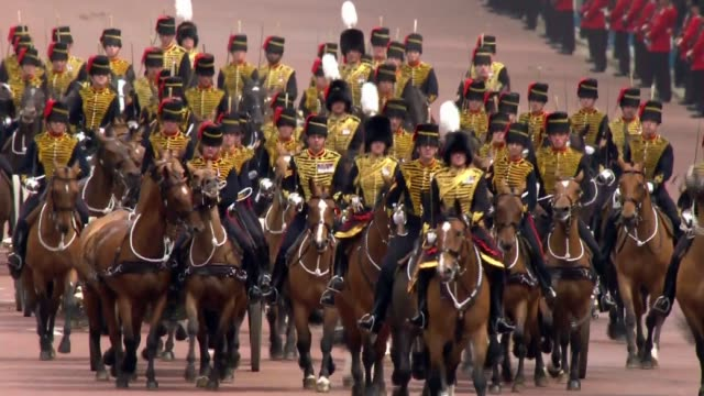 general views of trooping the colour **music heard in background sot** mounted troops along the mall / horsedrawn carriage along / procession along... - 90th birthday stock videos and b-roll footage