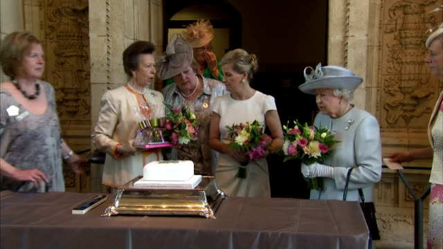 Queen Elizabeth and Anne Princess Royal being presented with gifts from the Women's Institute The Queen opened the centenary annual meeting of the...