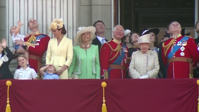 queen elizabeth and other royals appear on a balcony at buckingham palace to watch the flypast during the annual trooping the colour parade which... - royalty stock videos & royalty-free footage