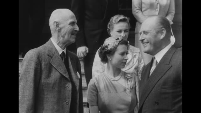 ws queen elizabeth and philip duke of edinburgh stand outdoors with crown prince olav of norway his son prince harald and woman who is probably... - king royal person stock videos & royalty-free footage