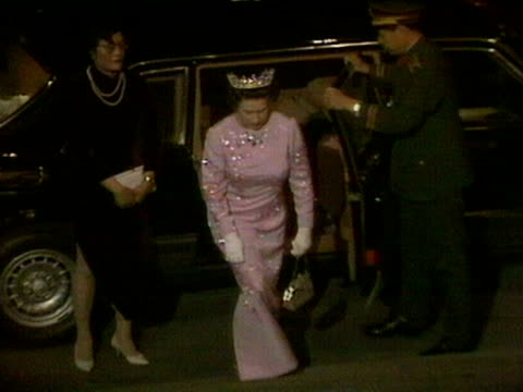 queen elizabeth and prince philip arrive at an evening function in beijing during her royal visit to china. october 1986. - crown headwear stock videos & royalty-free footage