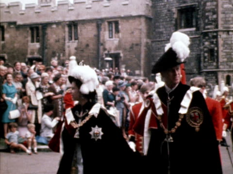 queen elizabeth and prince philip parade through windsor castle, wearing the regalia of the knights of the garter. 1968. - britisches königshaus stock-videos und b-roll-filmmaterial