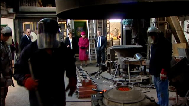queen elizabeth and prince philip tour london's east end cutaways hughes showing queen elizabeth round whitechapel bell foundry / worker operating... - foundry worker stock videos and b-roll footage