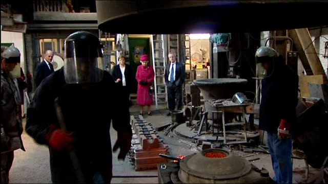 queen elizabeth and prince philip tour london's east end england london whitechapel bell foundry int good shots alan hughes showing queen elizabeth... - foundry worker stock videos and b-roll footage