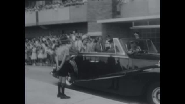 queen elizabeth and prince phillip arriving to open 'northcott' public housing block b redfern / boy scout opens the car door for the royals / crowds... - 1963 stock videos & royalty-free footage