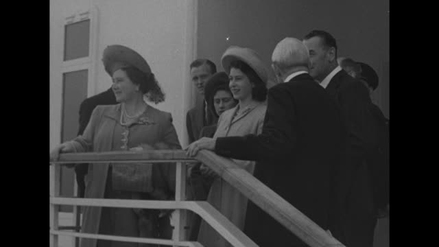 vs queen elizabeth and princesses elizabeth and margaret pass camera the queen admires a chair on her namesake ship the rms queen elizabeth / high... - princess elizabeth stock videos and b-roll footage