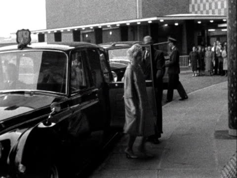 Queen Elizabeth arrives at BBC Television Centre and is greeted by two BBC officials 1961