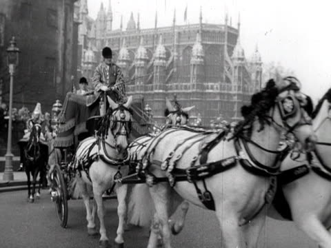 queen elizabeth arrives at the the houses of parliament for her first state opening of parliament 1952 - the queen's speech state opening of uk parliament stock videos & royalty-free footage