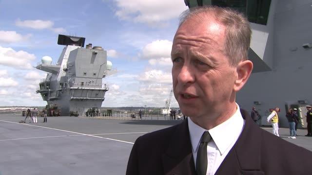 queen elizabeth arrives in portsmouth; england: hampshire: portsmouth: captain jerry kyd interview sot - hampshire bildbanksvideor och videomaterial från bakom kulisserna