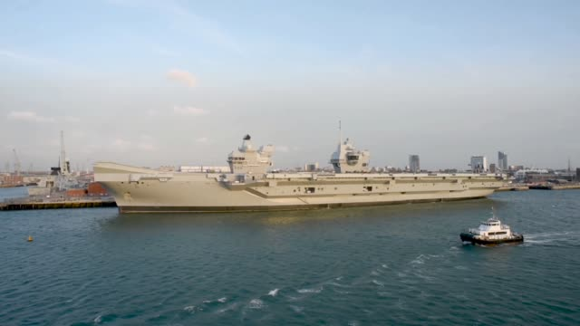 hms queen elizabeth at portsmouth naval dockyard - aircraft carrier stock videos & royalty-free footage
