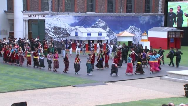 queen elizabeth attends gurkha anniversary event; rehearsal for gurkha bicentennial celebrations gurkhas in audience men and women taking part in... - historische szene stock-videos und b-roll-filmmaterial