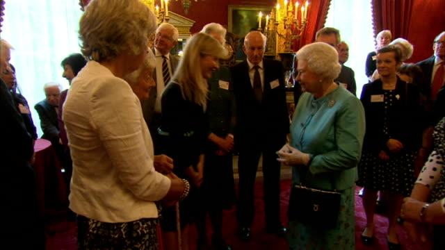 Queen Elizabeth attends 'Leonard Cheshire Disability' reception at St James's Palace Queen Elizabeth chatting with TV presenter Esther Rantzen...