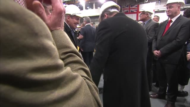 hms queen elizabeth commissioning service / queen greeting officers and signing log england hampshire portsmouth hms queen elizabeth int **music... - raw stock videos and b-roll footage