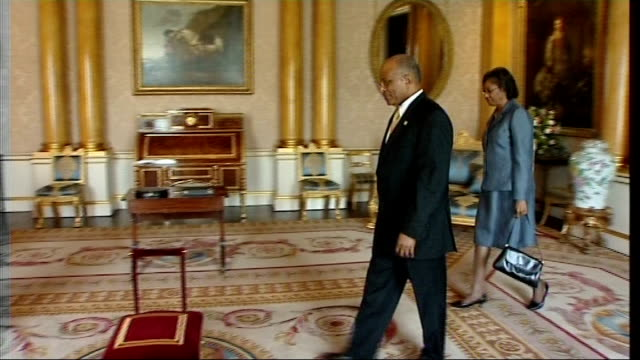 vídeos de stock, filmes e b-roll de queen elizabeth confers knighthhood on governor general of jamaica england london buckingham palace photography * * close up of printed court... - 2008