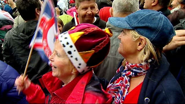 queen elizabeth diamond jubilee: crowds in the mall; **folllowing shots filmed amongst crowds** vox pops close shots of two women standing amongst... - diamond jubilee stock videos & royalty-free footage