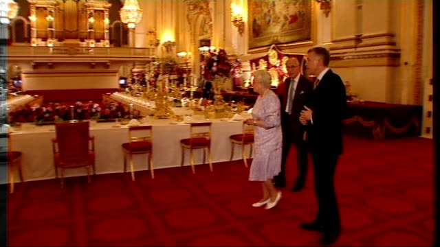 queen elizabeth examining place settings with assistant in banquet room - assistant stock videos & royalty-free footage
