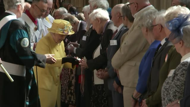 queen elizabeth hands out maundy money at windsor england london windsor castle st george's chapel int queen elizabeth and princess eugenie of york... - windsor castle stock videos & royalty-free footage