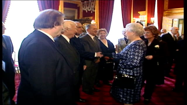 queen elizabeth hosts auschwitz 60th anniversary event at st james's palace; england: london: st james's palace: int further shots of queen elizabeth... - palace stock-videos und b-roll-filmmaterial