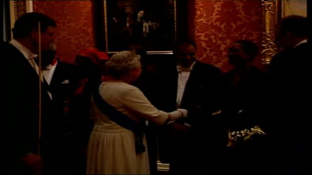 vídeos de stock, filmes e b-roll de queen elizabeth hosts buckingham palace reception england london buckingham palace int vars guests stand around chatting/ vars fanfare as queen... - 2006