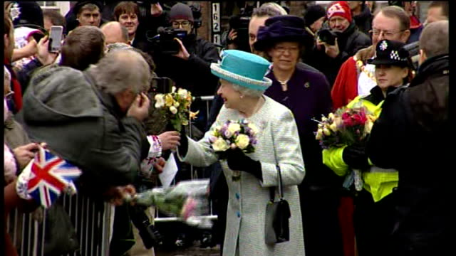 queen visits children in norfolk school queen on walkabout outside town hall queen carrying flowers smiling at wellwishers - queen elizabeth hall stock videos and b-roll footage