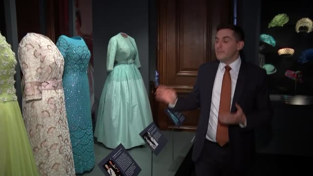 display of queen's clothing at hollyrood house close shot of dress with tartan material on display/ reporter to camera/ close shot of skirt made from... - tartan video stock e b–roll