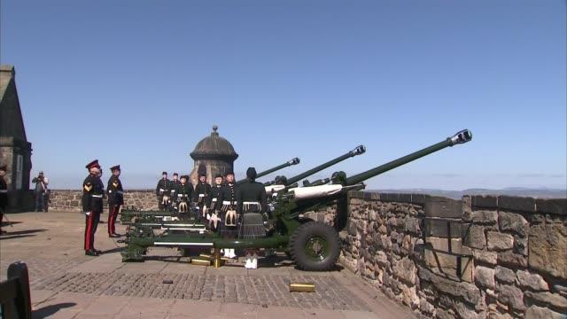 Edinburgh Castle gun salute Man with bagpipes