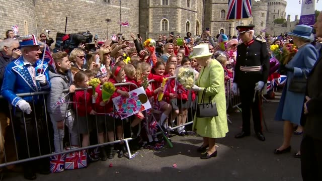 events england berkshire windsor ext queen elizabeth walkabout outside windsor castle greeting crowd sbehind barriers and accepting bunches of... - 90th birthday stock videos and b-roll footage