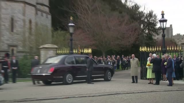 windsor beacon lit general view beacon / queen camilla and prince charles along / beacon burning / royals away in cars / military band along /... - 90th birthday stock videos and b-roll footage