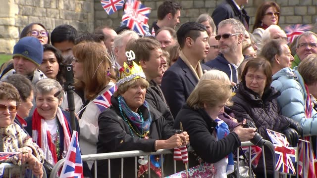 windsor crowds crowds outside windsor castle with union jacks waiting for queen - 90th birthday stock videos and b-roll footage