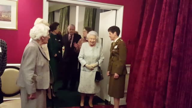 Queen Elizabeth II accompanied by the Princess Royal during a reception at the Army and Navy Club in central London to mark the centenary of the...