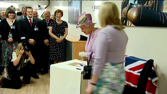 Queen Elizabeth II and Duke of Edinburgh visit Alnwick People applauding as Queen and Philip entering room / Queen unveiling plaque as Duke watches /...