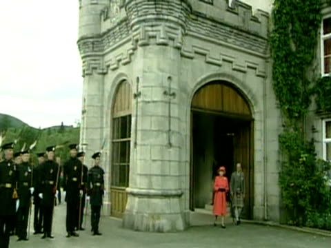 queen elizabeth ii and duke of edinburgh walk out of balmoral castle on the last day of the golden jubilee celebrations - golden jubilee stock videos & royalty-free footage