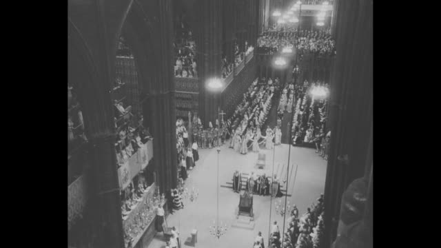 queen elizabeth ii and entourage make way down center aisle of westminster abbey flanked by life guards during her coronation ceremony / people in... - 1953 stock videos and b-roll footage