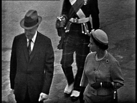 queen elizabeth ii and president dwight d eisenhower chat as they walk together to inspect guards balmoral 28 aug 59 - 1959 stock-videos und b-roll-filmmaterial