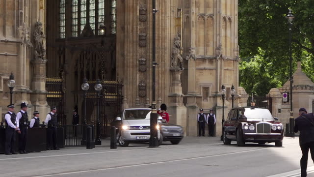 queen elizabeth ii and prince charles leaving the houses of parliament after delivering the queen's speech - the queen's speech state opening of uk parliament stock-videos und b-roll-filmmaterial