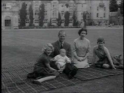 queen elizabeth ii and prince philip duke of edinburgh with their children prince andrew princess anne and charles prince of wales sitting on a... - königin elisabeth ii. von england stock-videos und b-roll-filmmaterial