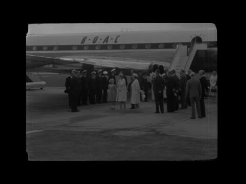 queen elizabeth ii and prince philip greeted on return from tour of canada; england; london: heathrow airport: ext queen elizabeth the queen mother... - greeting stock videos & royalty-free footage