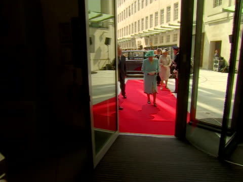 queen elizabeth ii arrives at new bbc hq broadcasting house and is greeted by lord patten and tony hall before entering and meeting other bbc... - queen elizabeth hall stock videos and b-roll footage