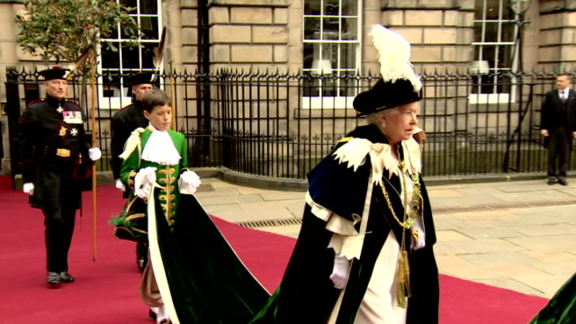 queen elizabeth ii attended an order of the thistle service at st giles' cathedral, as part of her holyrood week engagements. heralds led the... - scotland stock videos & royalty-free footage