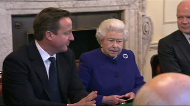 queen elizabeth ii attends conservative cabinet meeting at 10 downing street, sat next to prime minister david cameron, 2012 - premierminister stock-videos und b-roll-filmmaterial