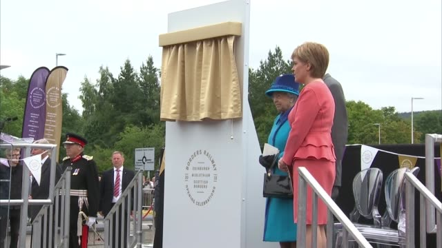 Queen Elizabeth II becomes longest reigning monarch Queen train journey Queen Prince Philip and Sturgeon on podium / band plays 'God Save the Queen'