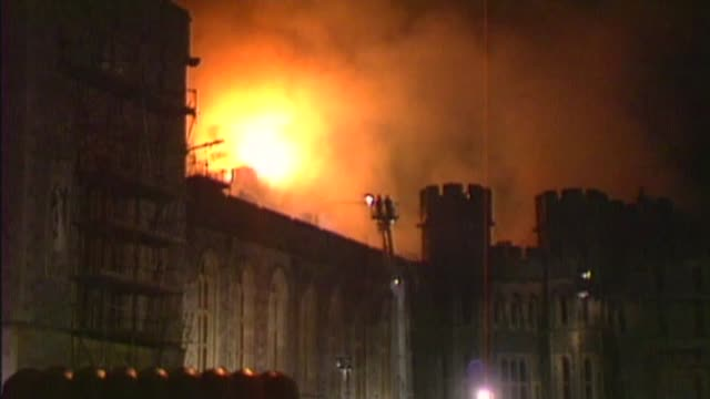 queen elizabeth ii becomes longest reigning monarch t20119201 various of windsor castle on fire day queen talking to firefighters - windsor england stock videos & royalty-free footage