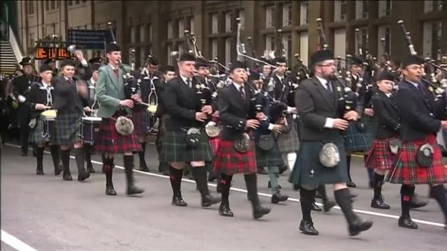 queen elizabeth ii becomes longest reigning monarch: view from train; bagpipe marching band along sot - bagpipes stock videos & royalty-free footage