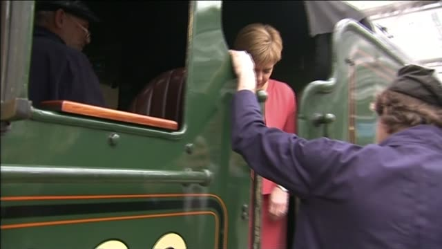 queen elizabeth ii becomes longest reigning monarch: view from train; **band playing sot*** sturgeon onto train cab and chatting to staff madge... - 皇族・王族点の映像素材/bロール