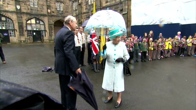 queen elizabeth ii braves weather with umbrella at lancaster castle courtyard and walks past cheering group of cub scouts and brownies on may 29 2015... - atlanta braves stock-videos und b-roll-filmmaterial
