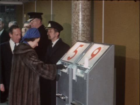 queen elizabeth ii buys a tube ticket and passes through the gates at green park tube station during the opening of the new victoria line tube - elizabeth ii stock videos & royalty-free footage