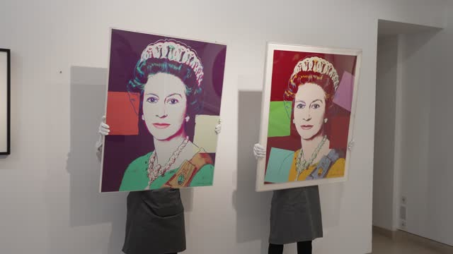 queen elizabeth ii' by andy warhol on display during preparations taking place ahead of online sales at christie's auction house on march 26, 2021 in... - currency symbol stock videos & royalty-free footage